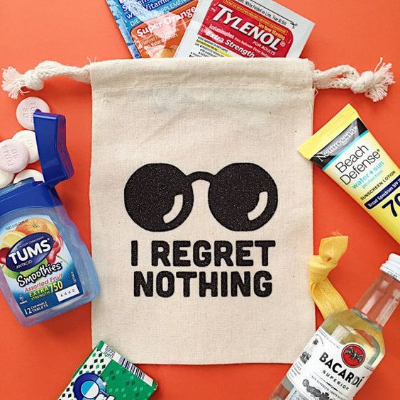 fabric bag with drawn sunglasses and text saying I regret nothing